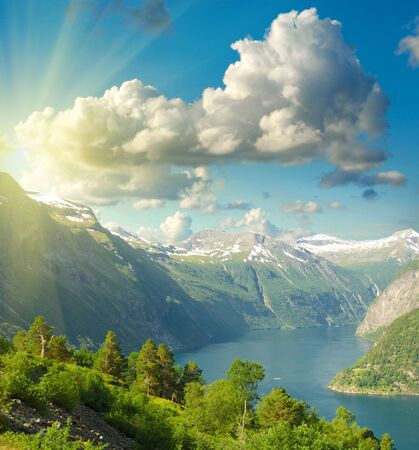 Summer landscape. Blue sky, mountains and fjord photo