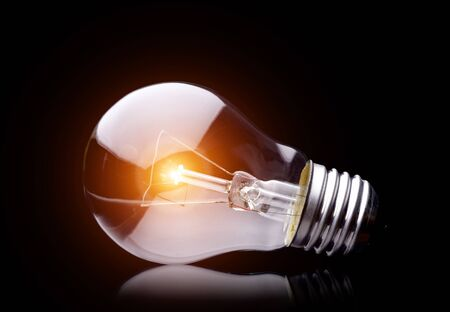 Photo of light bulb on black  Stock Photo - 11743739