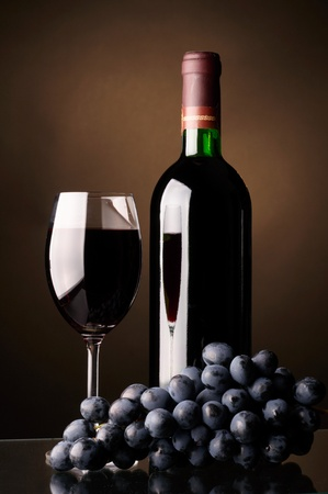 Glass and bottle of red wine photo