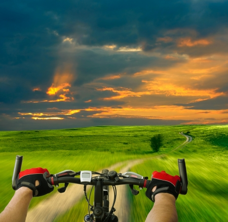 Man with bicycle riding country road Stock Photo
