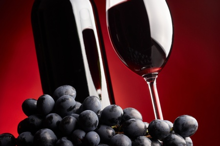 wine testing:  Glass and bottle of red wine Stock Photo