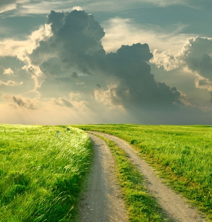 dirt road: Summer landscape with green grass, road and clouds