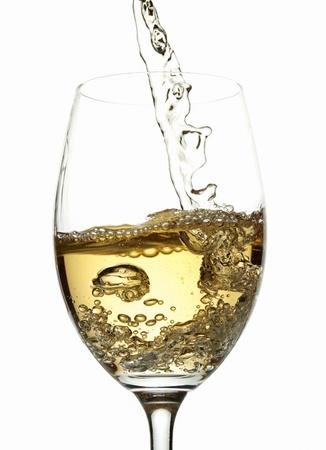 splashing: White wine pouring into glass Stock Photo