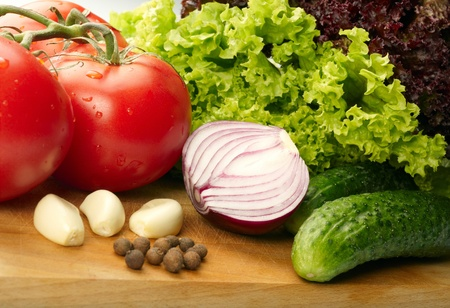 Fresh vegetables on wooden hardboard photo