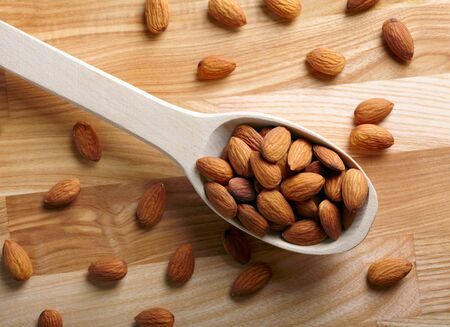 Almonds on wooden background photo