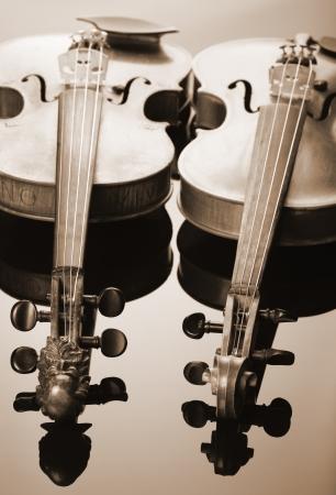 violins: Two violins on dark background Stock Photo
