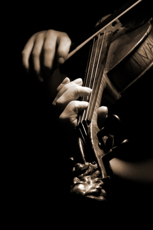 Musician playing violin isolated on black Stock Photo