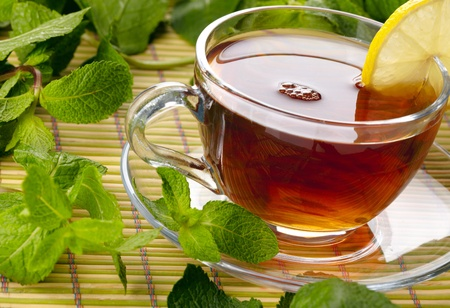 Cup of tea with lemon and mint Stock Photo - 13681670