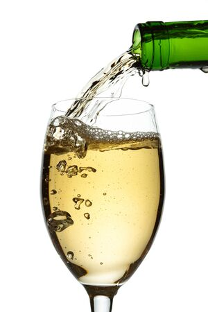 White wine pouring into glass Stock Photo - 13698573