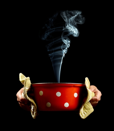 cooking pot: Pan with smoke in hands