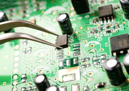 tweezers: Assembling a circuit board