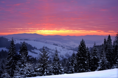 Beautiful sunrise in the winter mountains Stock Photo