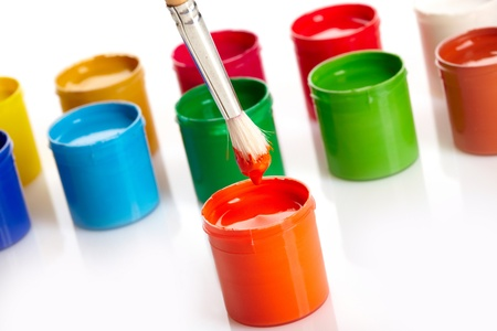 wood craft: Paint buckets with paintbrush over white background