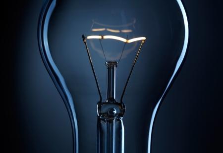 filaments:  Light bulb over dark background