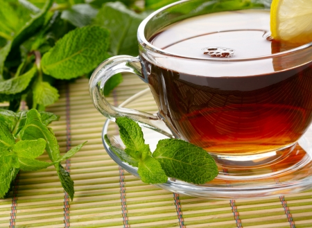 herb tea: Cup of tea with lemon and mint Stock Photo