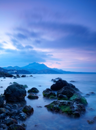 con dao: Sea stones at sunset