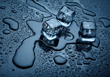 solid blue background: Ice cubes over dark background
