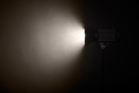 stage set: Theater spotlight over black background