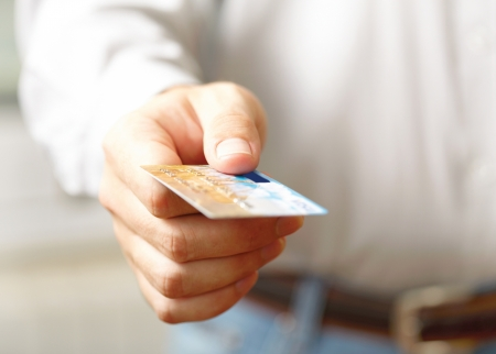 trade credit: Hand with credit card  Shallow DOF