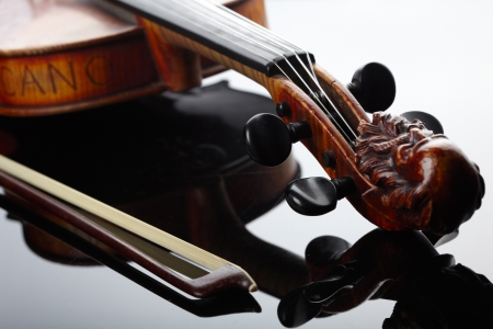 Violin and bow on dark background  Stock Photo - 17196577