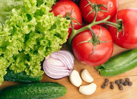 bulbet: Fresh vegetables on wooden hardboard
