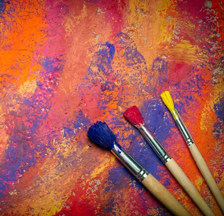 Paintbrushes on abstract grange background photo
