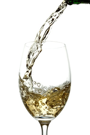 white wine: White wine pouring into glass Stock Photo
