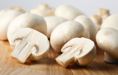 champignon: Champignon on wooden background Stock Photo