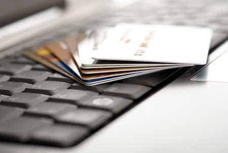 Credit cards and laptop. Shallow DOF  photo