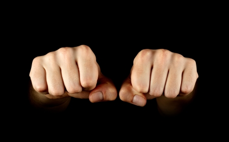 Two fists isolated on black background