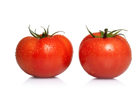 Two tomatoes isolated on white background  photo