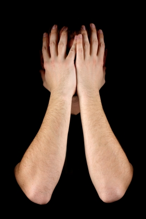 Man hiding his face on black background Stock Photo - 17608179