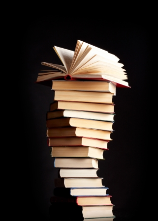 Pile of books on a black background Stock Photo