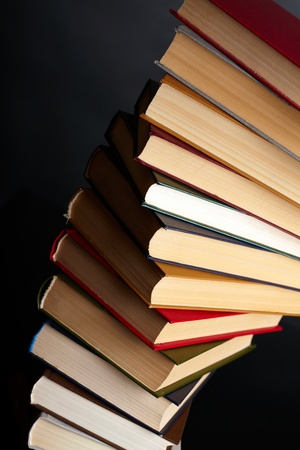 Pile of books on a black background Stock Photo - 17608924