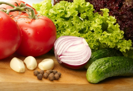 Fresh vegetables on wooden hardboard