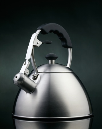 Tea kettle over dark background Stock Photo - 17608709