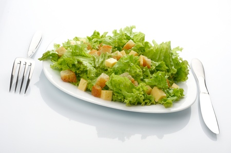 caesar salad: Close-up of salad on white plate