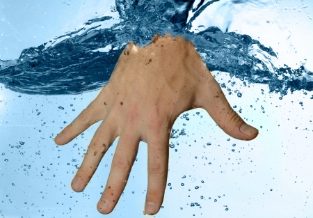 cleanly: Human hand in water Stock Photo