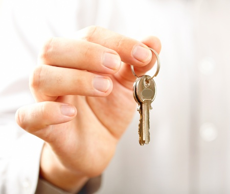 Man holding key. Shallow DOF, focus on key  photo