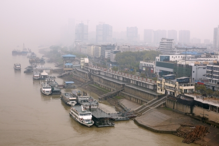 urbanized: Smoke in the air. Wuhan, China Stock Photo