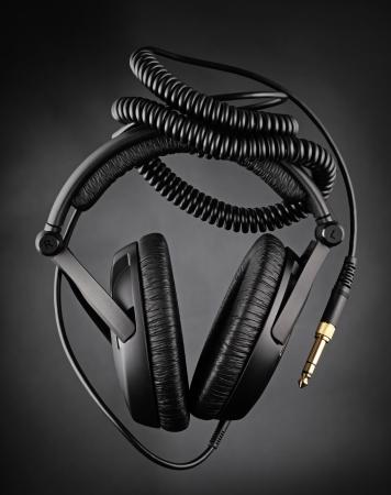 bass player: Modern headphones over dark background Stock Photo