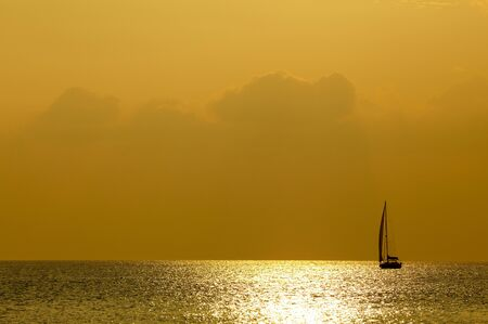 Sunset sea and yacht photo