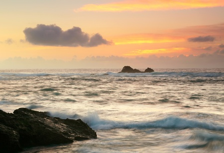 storm sea: Landscape with ocean, roks and sunset sky Stock Photo