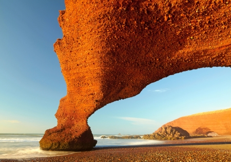 Great: Red archs on atlantic ocean coast. Morocco Stock Photo