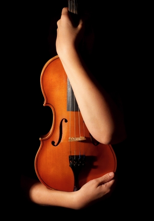 Old violin in woman hands Stock Photo