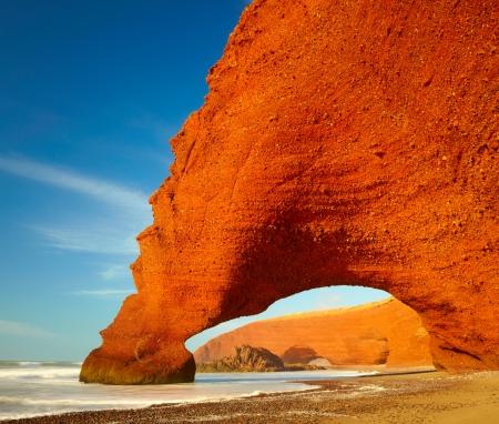 Red archs on atlantic ocean coast. Marocco photo