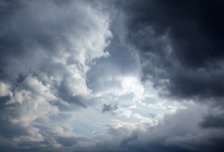 moody sky: Dark storm clouds background Stock Photo