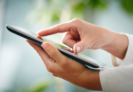 Hands and tablet PC photo