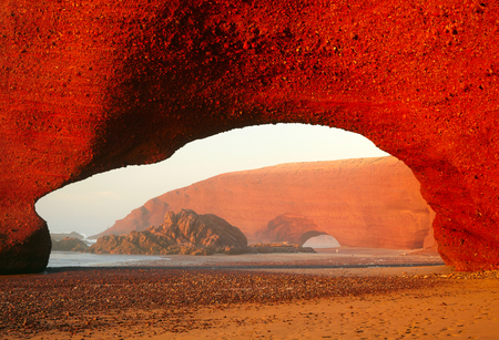 marocco: Red archs on atlantic ocean coast. Marocco