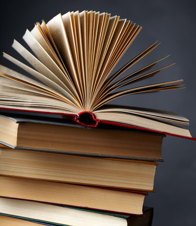 bibliography: Pile of books on a black background  Stock Photo